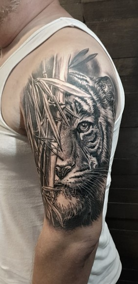tiger with bambu tattoo.jpg